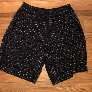 Black Lululemon shorts with silver dashes